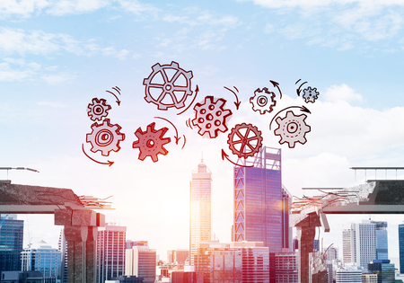 Sketched gear mechanism over gap in concrete bridge as symbol of teamwork and problem solving. Cityscape and sunlight on background. 3D rendering. Stockfoto