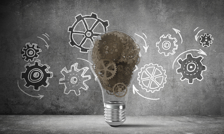 Lightbulb with multiple gears inside placed against sketched gear mechanism on grey wall on background. 3D rendering.