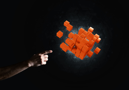 Close of man hand holding cube figure as symbol of innovation. 3D rendering