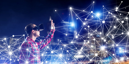 Young man with virtual reality headset or 3d glasses among connection lines Stock Photo