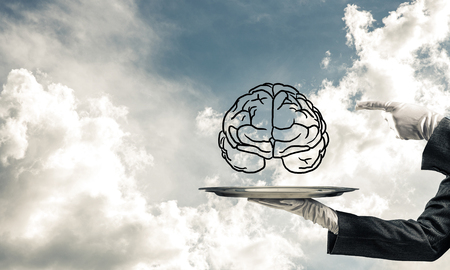 Cropped image of waitress's hand in white glove presenting sketched brains on metal tray and pointing on it with cloudy skyscape on background. 3D rendering. Stock Photo