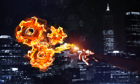 Fire burning gear mechanism on night city background Banco de Imagens - 92549276