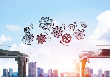 チームワークと問題解決のシンボルとしてコンクリート橋の隙間にギア機構をスケッチ。背景に街並みと日光。3D レンダリング。