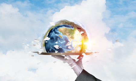 Cropped image of waitresss hand in white glove presenting Earth globe on metal tray with cloudy skyscape on background. 3D rendering.