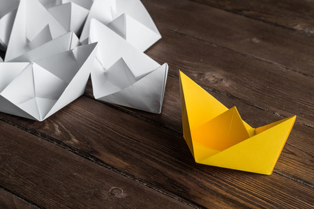 Set of origami boats on wooden table 스톡 콘텐츠