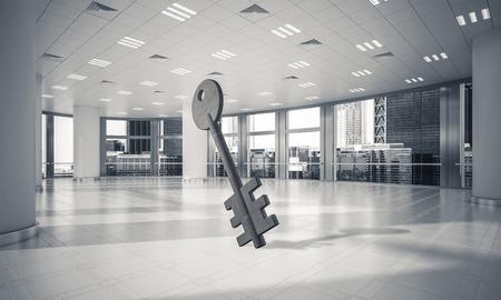 エレガントなオフィスルームでのアクセスのシンボルとしてのキーストーンフィギュア。3D レンダリング