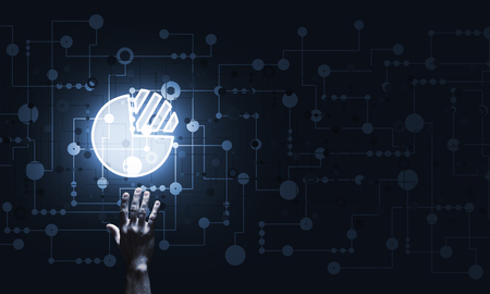 Close of businessman hand pointing with finger at graph icon on dark background
