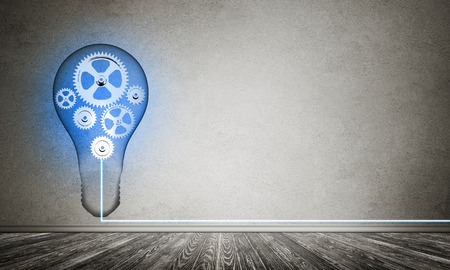 Blue glowing lightbulb with multiple gears inside placed in empty room with grey wall on background. 3D rendering.