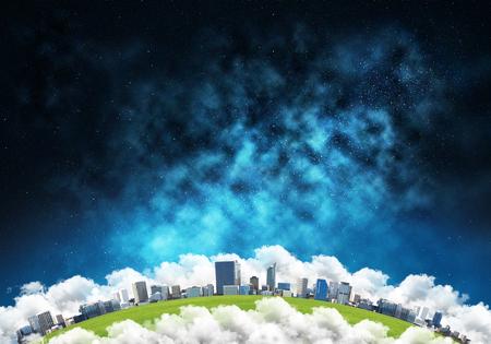 宇宙からの建物とエアロスタットと雲の惑星地球の抽象的なパノラマビュー。背景に暗い空間のヘイズ。 写真素材