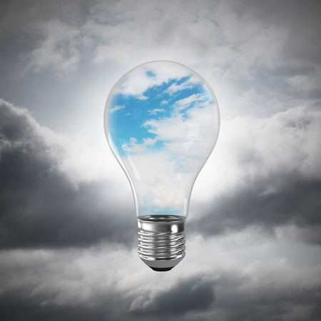 Glass lightbulb with clouds inside with grey cloudly skyscape on background. 3D rendering.
