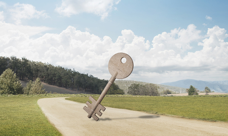 Key stone figure as symbol of access outdoor against natural landscape Stock Photo - 96502804