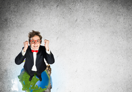 Top view of funny businessman in red glasses celebrating success. Imagens