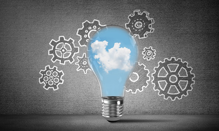 Lightbulb with cloudly skyscape inside placed against sketched gear mechanism on grey wall on background. 3D rendering.