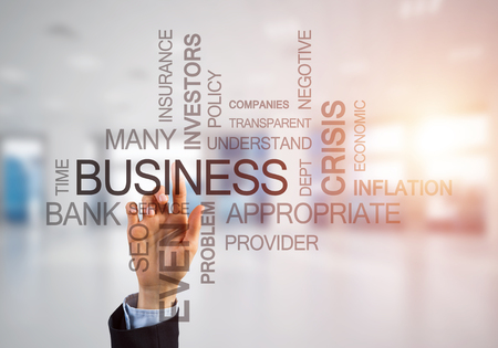 Close of businesswoman hand touching with finger screen with business conceptual words
