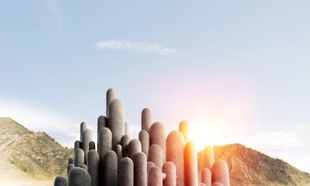 Image of high and huge stone columns located outdoors with beautiful landscape on background. Wallpaper, backdrop with copyspace. Stock Photo