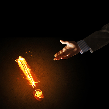 Businessman hand and fire glowing exclamation mark Banque d'images - 101047271