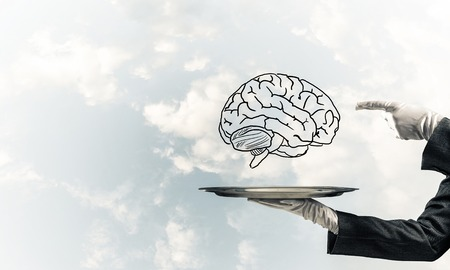 Cropped image of waitresss hand in white glove presenting sketched brains on metal tray and pointing on it with cloudy skyscape on background. 3D rendering. Stock Photo