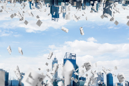 Abstract image of two modern urban worlds located among flying papers and upside down to each other on the sky background. Wallpaper, backdrop with copyspace.