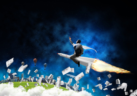 Conceptual image of young businessman in suit flying on rocket among flying papers with planet Earth and open space on background.