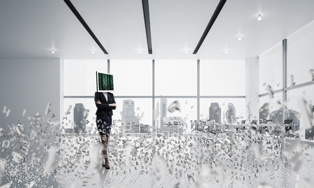 Business woman in suit with monitor instead of head keeping arms crossed while standing among flying letters inside office building. 3D rendering.