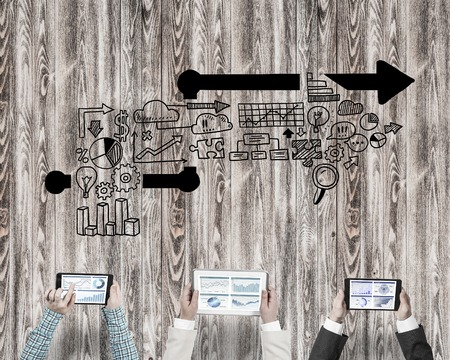 Group of people with devices in hands working together as symbol of networking and communication Stock Photo