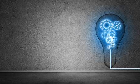 Blue glowing lightbulb with multiple gears inside placed in empty room with grey wall on background. 3D rendering. Imagens - 103275616