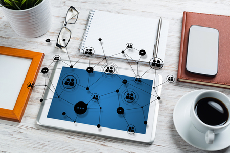 Top view of modern workplace with office stuff and social network connection above presenting still office life. Mixed media. Stock Photo
