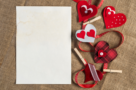 Handmade love hearts and sheets of blank paper Stock Photo