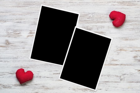 Blank photo frame and love hearts on wooden table Stock fotó