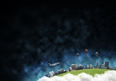 Abstract panoramic view at planet Earth in clouds with buildings and aerostats from space. Dark space haze on background.