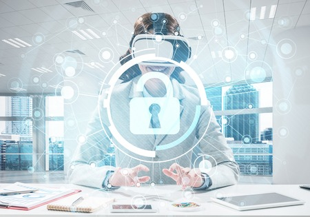 Conceptual image of young successful business woman sitting inside office and using virtual reality headset with security media interface Stock Photo - 105202924