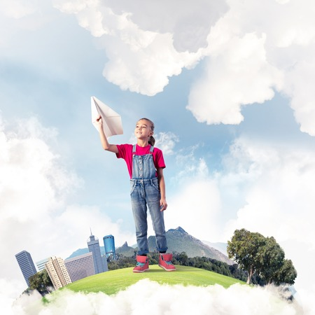 Cute kid girl on city floating island throwing paper plane Stockfoto