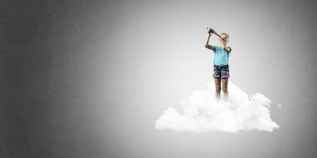 Cute kid girl on cloud looking in spyglass