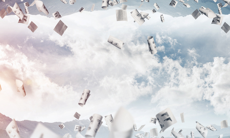 Abstract image of two nature worlds located among flying papers and upside down to each other on sky background. Wallpaper, backdrop with copyspace.