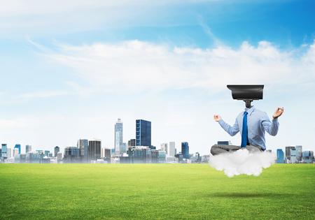 Elegant businessman outdoors floating on cloud and camera instead of head 版權商用圖片