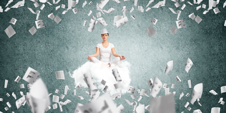 A woman in white clothing meditating on flying cloud