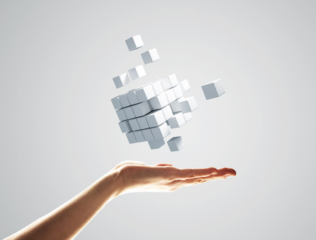 Close of businessman hand holding cube figure as symbol of innovation. 3D rendering 写真素材