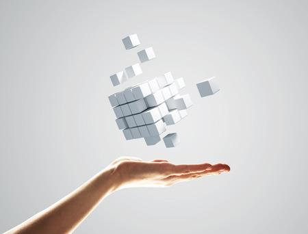 Schließen der Geschäftsmannhand, die Würfelfigur als Symbol der Innovation hält. 3D-Rendering