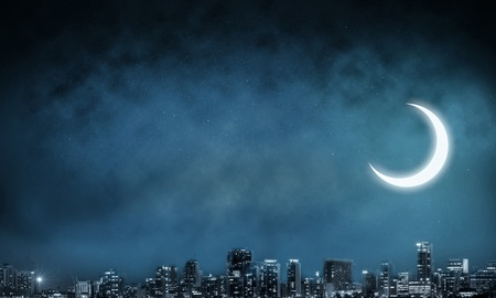 Abstract image of cityscape view at night with dark blue skyscape and moon on background. Wallpaper, backdrop with copyspace.