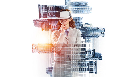 Double exposure of businesswoman wearing virtual reality glasses and modern cityscape