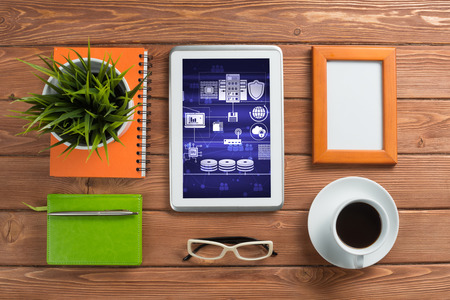 Top view of business workplace with tablet notepad coffee cup and other items Stock Photo