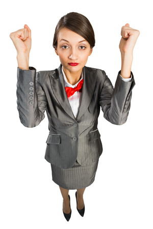 Top view of young cheerful businesswoman on white with fists up