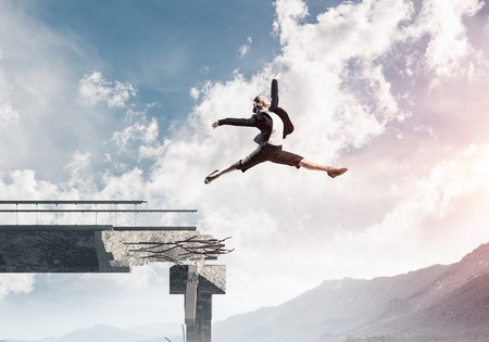 Business woman jumping over huge gap in concrete bridge as symbol of overcoming challenges. Skyscape and nature view on background. 3D rendering. Banco de Imagens - 111509714