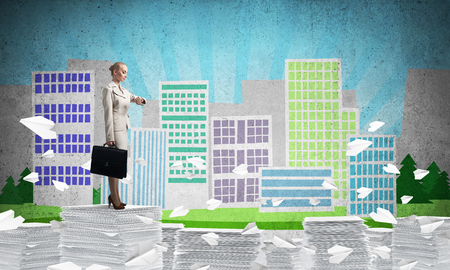 Business woman in suit standing among flying paper planes with sketched cityscape view on background. Mixed media. 스톡 콘텐츠