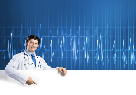 Young handsome doctor holding white blank banner. Place your text Stock Photo - 112029714