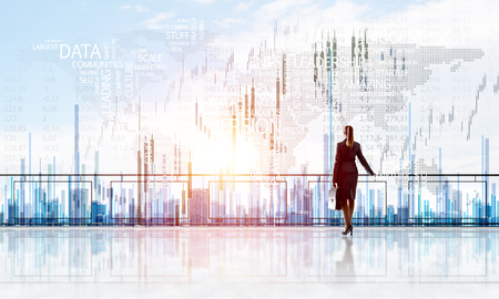 Young businesswoman in suit at balcony against morning cityscape background