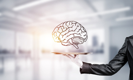 Cropped image of waitresss hand in white glove presenting sketched brains on metal tray with office view on background. 3D rendering.