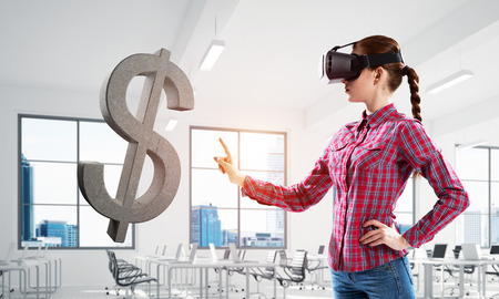 Young woman in virtual reality helmet and dollar stone symbol. Mixed media