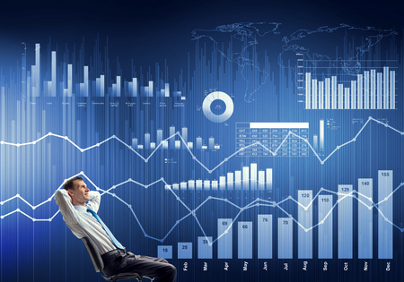 Young businessman sitting on chair with hands on head looking at virtual panel Stock Photo - 112551231