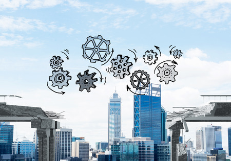 Sketched gear mechanism over gap in concrete bridge as symbol of teamwork and problem solving. Cityscape on background. 3D rendering. Stockfoto